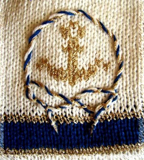 Вышивка по вязаному полотну золотыми нитями.